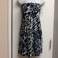 """Strapless print dress Blue/green animal print strapless dress. Has a loop for a halter option, but I don't have the """"necklaces"""" rayon sondes blend. Fully lined Marciano Dresses Strapless"""