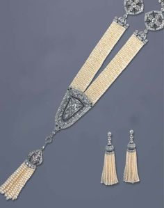 Diamond, onyx, pearl and platinum suite, comprising of a necklace and a pair of earrings, circa Tassel Jewelry, Pearl Jewelry, Jewelry Art, Fine Jewelry, Jewelry Design, Bridal Jewelry, Tassel Earrings, Pearl Bracelets, Diamond Necklaces