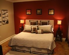 red bedroom paint with green accents. dark wood furniture. | itty