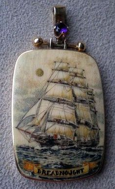 Magnificent Scrimshaw Ivory Tall Ship in a 14k Gold Frame.
