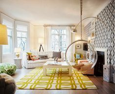 Cool Glass Hanging Chair Feat Yellow Area Rug Idea And Trendy Arc Floor Lamp On Living Room Add Your Living Room with Arc Floor Lamp to Get the Best Reading Experience There Living Room Design