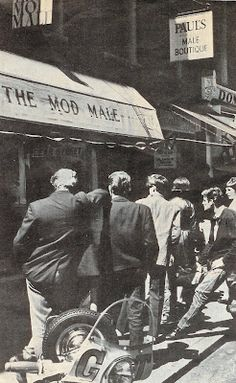 """The Mod Male, Carnaby Street, mid 1960s  The mods were the first of many subcultures to draw positive influence from West Indians in GB. The mod was a """"typical lower class dandy"""" who paid particular attention to detail. """"The mods invented a style which enabled them to negotiate smoothly between school, work, and leisure, and which concealed as much as it stated"""" (52). Essentially, Hebdige is explaining that mods took the idea of neatness and pushed it to an extreme, they were always """"too""""…"""