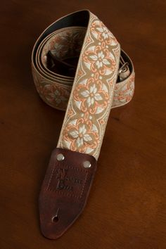 Beige/Ivory/Peach Vintage-styled Guitar Strap. Each Nowhere Bear strap has hand crafted leather ends stamped with the Nowhere Bear logo and is