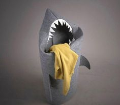 The shark laundry basket is a hamper that is designed in a way that you throw your dirty clothes into the mouth of the shark. Perfect to place in the bathroom to toss your soiled pantalones into after...