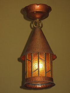 Great looking vintage porch light with its original finish and patina. All glass is original pebble glass with no broken panels and no broken seams between glass panels. This style would be a welcome home for any bungalow, cottage, or craftsman home.   Height: 13 inches  Width: 6 inches http://www.vintagelights.com/product/1/late-20s-early-30s-copper-ceiling-mount-porch-light.html
