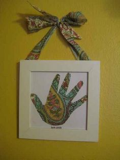 Trace around the childs hand on a pretty piece of scrapbook paper to match your room. Makes a great gift for grandparents too. Use with frames from dollar tree, tied with ribbons
