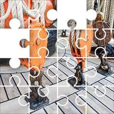 Red Rope Blocks Jigsaw Puzzle, 100 Piece Classic. Metal rope blocks on an old sailing ship. wood decking, orange and red