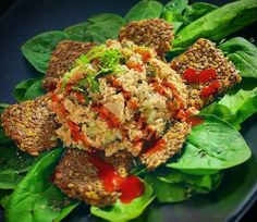 """Tonight's simple and easy #keto dinner: Tuna salad with flax seed crackers and spinach!!  4.6oz of tonno tuna in olive oil 9g whole foods mayo .75oz Sriracha aioli sauce 3 pickle sandwich slices and 1oz of spinach. Eaten with roughly 12 """"Flackers"""" from Doctors In The Kitchen and drizzled with my own mix of Sriracha and sugar-free ketchup that actually went surprisingly well together  Super tasty!!! 630 calories 5g net carbs 47g fat 41g protein  #ketogenic #ketogenicdiet #ketosis #ketoliving…"""