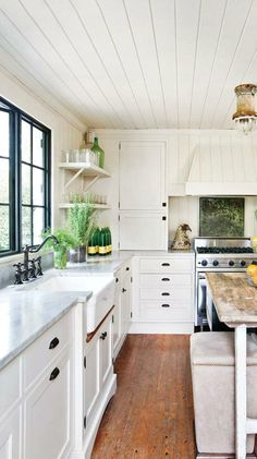 This collection of rustic home inspiration proves that it doesn't take a lot to give your home that cozy feel—all you need is shiplap! With ideas for where to use shiplap, this bright white kitchen is our favorite for sparking a design makeover.