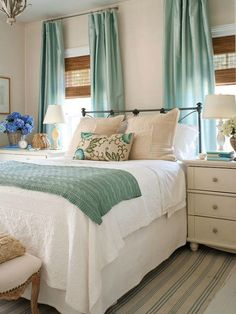 White and cream together with accents of aqua.  Love the metal headboard.  Fashion bed group has many options for metal beds.