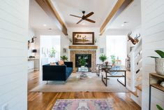 Spacious open living room with masculine accents Living Area, Living Room Decor, Bold Wallpaper, Charleston Homes, Baby Gates, Master Closet, Custom Cabinets, Next At Home, Rental Property