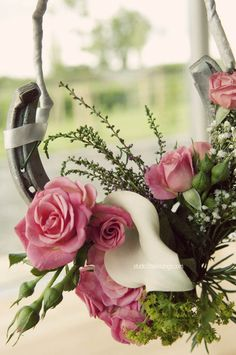 horse shoe adorned either with flowers, wrapped with pearls etc. Hung somewhere or added onto a decor table. Personalizes the fact that you have horses in your life and luck! LOVE this!! We could hang above the head table