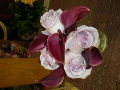 Lavender roses with plum calla lilies compliment the Brides bouquet