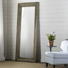<p>The right mirror can add dimension to your space while also elevating your ensemble, and this one is the perfect pick,</p><p>Its mirror, highlighted by a distressed manufactured wood frame, is the ultimate morning prep must-have. With subtle tones of blue and green, it brings a dash of color to any neutral-hued ensemble.</p><p>Use it to take your entryway from blah to beautiful, just add in a complementing woven jute rug, then sit a patterned arm cha...