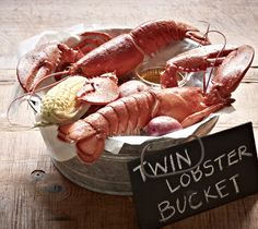 #JoesCrabShack #JoesMaineEvent -  Joe's Crab Shack - The Maine Event - Twin Lobster Bucket: Two whole split lobsters, corn and potatoes boiled in a garlic bath and topped with Old Bay® Seasoning.