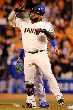 SAN FRANCISCO, CA - OCTOBER 26: Pablo Sandoval #48 of the San Francisco Giants reacts after hitting a single in the eighth inning against the Kansas City Royals during Game Five of the 2014 World Series at AT&T Park on October 26, 2014 in San Francisco, California. (Photo by Elsa/Getty Images)