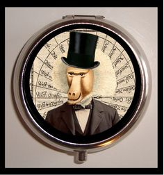 Victorian Steampunk Inspired Surreal Baboon Monkey Man in Top Hat Pill Box Case Stainless Steel Sweetheartsinner. $7.50, via Etsy.
