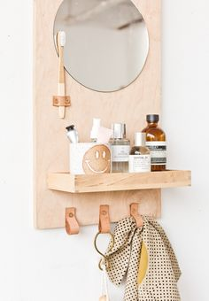 Learn how to make a modern DIY bathroom organizer (with mirror) out of scrap plywood. Click through for the tutorial. #diybathroom #organicmodern #bathroomorganizer #diyorganizer #diy #woodproject #plywoodproject #modernbathroom