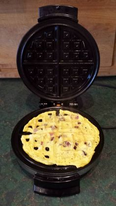 Cook eggs in the waffle iron. Scramble two eggs, season with salt and pepper, add in some chooped onions, ham, mushrooms ... whatever you fancy. Spray waffle iron with oil and preheat. Pour eggs onto the waffle iron and close. Let sit for a minute or two and voila. Easy clean up too.