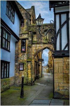 Ancient town of Sherborne, Dorset, England - people used to be hung from this gateway.