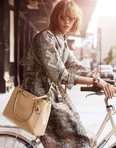 Never underestimate the power of a versatile Printed Trench.Via leggy all-American model Karlie Kloss in Coach's S/S 14 ad campaign.