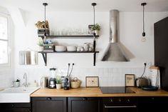 wood countertop, dark cabinets, open shelving