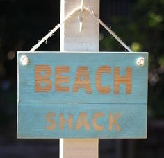 'Beach shack' reclaimed timber sign with rope hanging.  Size is  34cm wide by 23cm high and 2cm thick  Only one available can can custom make if you require a different colour.