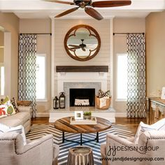 Modern Rustic Family Room...I love this look, especially the way they've done the curtains and mirror