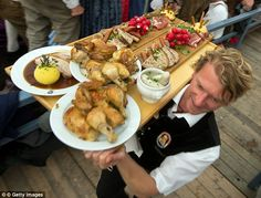 Hefty: Vast amounts of meat and bread are also consumed at Oktoberfest