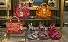 Miu Miu must have - top handle leather handbags in pops of color