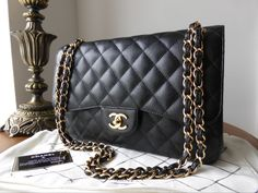 Chanel Timeless Classic 2.55 Jumbo Flap Bag in Black Caviar with Gold  Hardware - SOLD 04ba2f5bb46