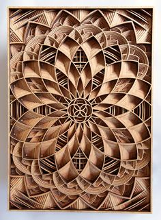 Artist Gabriel Schama creates intricately layered wood relief sculptures using…