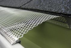Aluminum mesh gutter protection. The curved surface helps to prevent debris from collecting on top of the mesh.