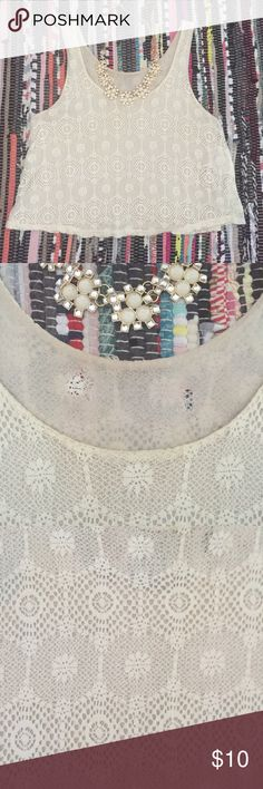 Cream Crochet Overlay Crop Top Perfect top to pair casually with cut offs or dress up with heels! Tag was very itchy, so it has been cutout--photo below. Forever 21 Tops Crop Tops