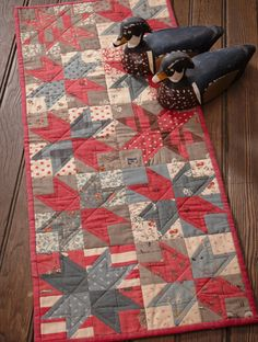 Nice use of french general fabrics.  Martingale - Back to Charm School Quilted Tablerunner - Red white and blue