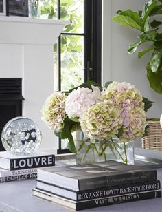Vignette, table styling.  For similar pins please follow me at - https://www.pinterest.com/annelouise1959/vignettes-coffee-table-styling-gallery-walls/