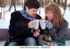 Young Beloved Couple Warming Themselves In The Winter Park Stock ...