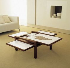 Coffee Table - Love  Rectangular surfaces slot into place for compact storage when not in use, and pull out to whatever length is required for a given task. No flip-up, fold-down, just simple sliding motions to increase or decrease available dining, work or side-table space.