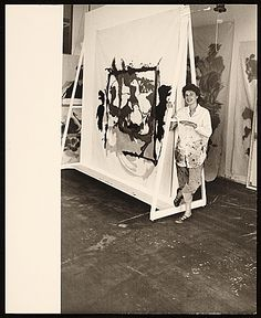 Helen Frankenthaler with one of her paintings, 1961. http://www.pinterest.com/ogmundurs/abstract-expressionists/