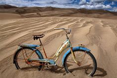 """Dune Cruiser by Todd Van Fleet  - No bike should spend its life on the sidewalk. That's why Todd Van Fleet rescues bikes, """"Snapping the shutter is the easy part. Finding the bikes is where the real adventure begins."""" Toddrescues old cruiser bikes from the corners of barns, sheds, and attics; then straps them to his back and hikes to far-flung, lonely landscapes giving each bike a story in a photo.Todd's ...Click any image and read more and see more. Tags: bike,bikes,cycling,bicycling,riding,"""
