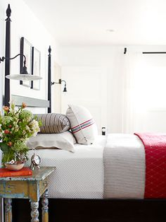 Love the sconces on either side of the bed.