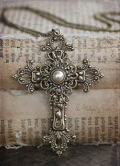 An ornate, Victorian inspired cross in aged brass. She makes so many pretty things : )