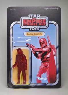 Figure 23 in a 26 figure series. This piece is colored translucent red. The figure comes mounted in a blister bubble on a custom cardback. Of all the bootlegs to come about in the 70's and 80's, the Polish Star Wars bootlegs are among the best/worst of them all. The pinnacle of that collection was the Polish Bootleg Boba Fett. Recreated here in his un-articulated single-cast glory is a tribute to that Polish Bootleg Fett.