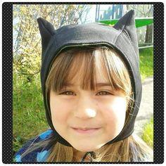 Batman hat. Kcw oct 2015. Free cat/bunny ears pattern but changed the ears to look more like old batman.
