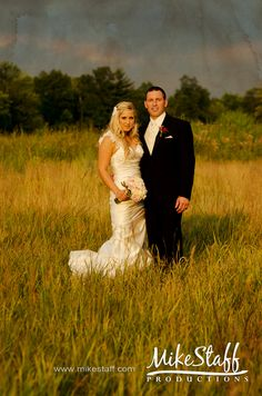 Picture of zoey and tyler either in a wheat field or in a field of grass