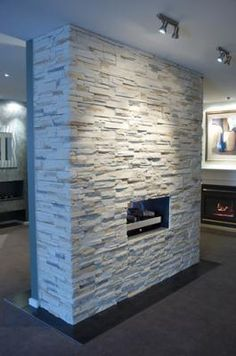 Create a warm fire place look with Infiniti Stone® stack stone veneer & dry stone wall cladding. Infiniti Stone lightweight stone cladding distributed throughout Australia by InfinitiStone - Melbourne. Stacked Rock Fireplace, River Rock Fireplaces, Double Sided Fireplace, Stone Fireplaces, House Cladding, Stone Cladding, Wall Cladding, Fireplace Remodel, Fireplace Wall