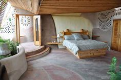 earthship bedroom - love the texture and shapes; could never in the world keep it this clean or free of stuff on the walls, LOL