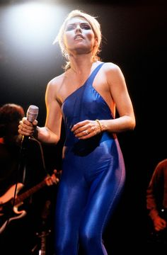 Singer Deborah Harry wears a metallic jumpsuit during a live show with band Blondie, United States, 1981, photograph by Chris Gabrin.