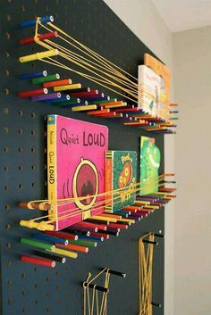 I love it, not just for kids! DIY pegboard and colored pencils to create a fun bookshelf in a kids room Diy Projects For Kids, Diy For Kids, Cool Bookshelves, Bookcase, Ideas Para Organizar, Interactive Art, Ideias Diy, Wall Storage, Diy Storage
