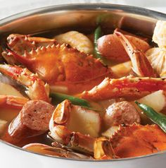 Host an indoor picnic with a Traditional Crab Boil. Cover your kitchen table with butcher paper, pour out the crabs, sausages, potatoes and green beans, and dig in!